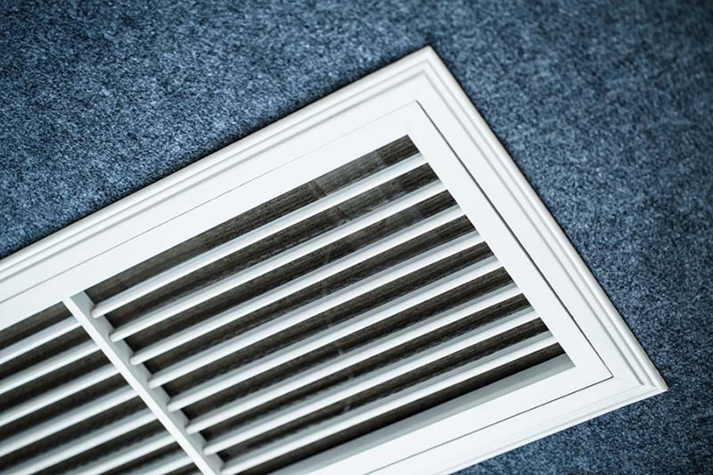 ac definitions, air conditioning lingo, close up shot of the vents of an air conditioner