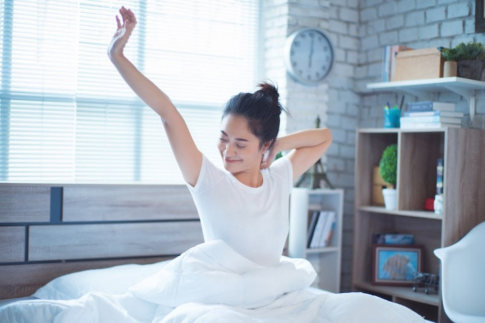 well rested woman after waking up