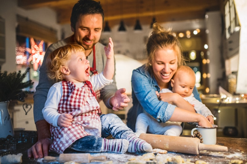 6 ways your furnace keeps you safe, happy family of four baking together