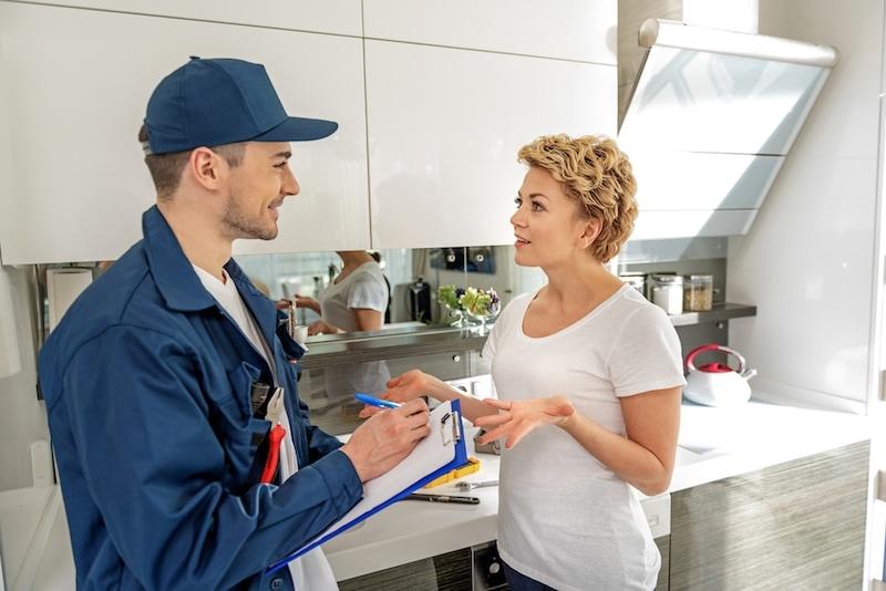 Technician Explaining AC Maintenance To Customer