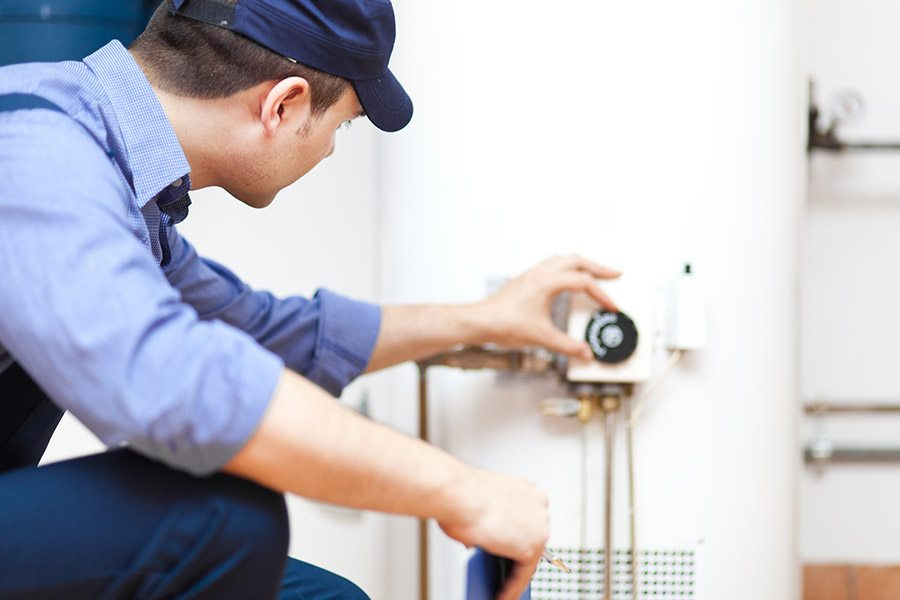 Technician check in a water heater in oregon